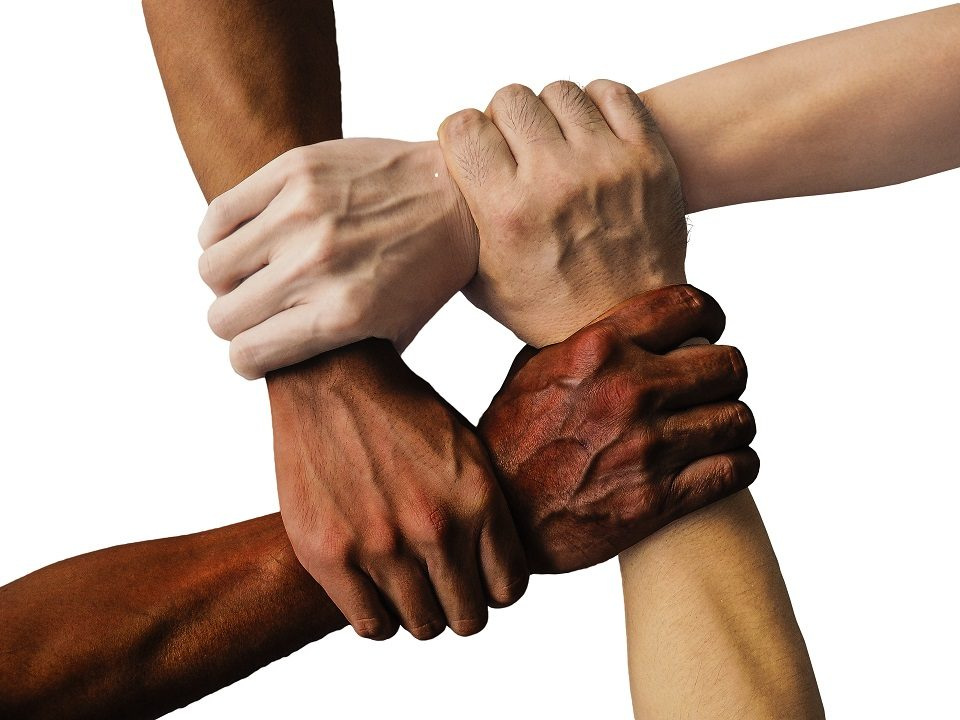 Diversity shown through holding hands