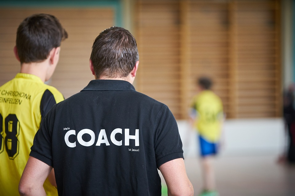 Photograph of a youth and his coach