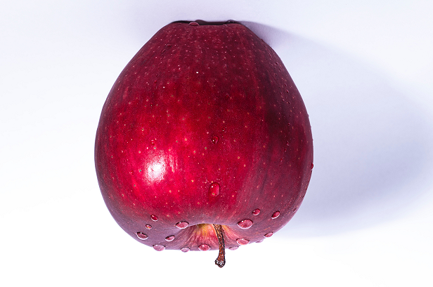 photograph of an upside down apple