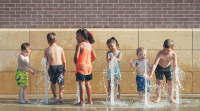 Photograph of children playing in a fountain