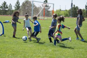 photograph of children playing soccer