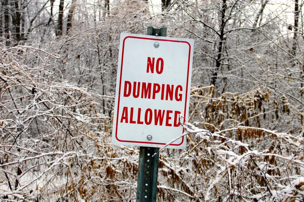 "photograph of a ""no dumping"" sign"