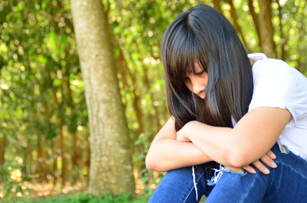 Photograph of a sad teenager