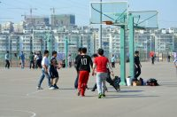 Photograph of kids playing basketball