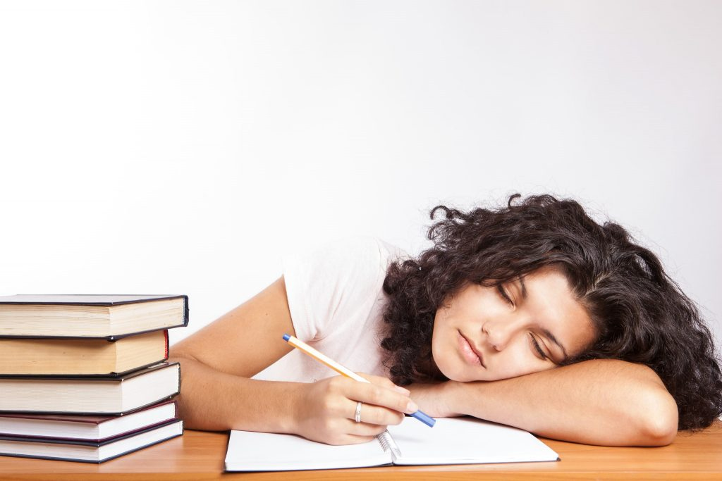 Photograph of a tired teen