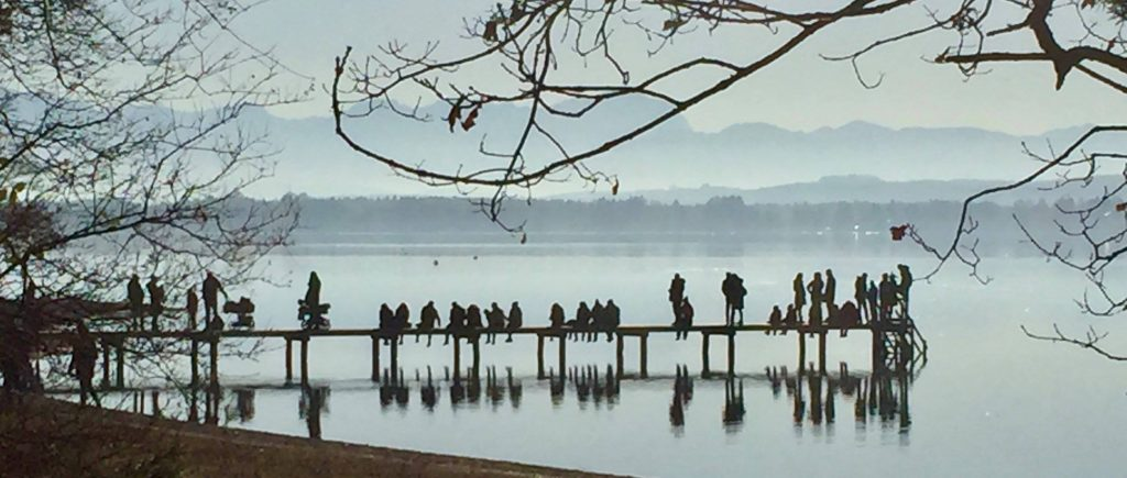Photograph of people sitting on a dock