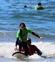 Photograph of girl surfing