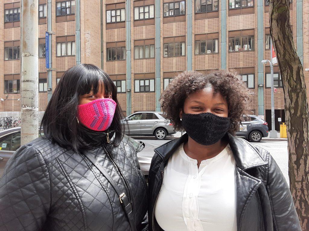 Photograph of two women wearing masks