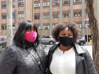 Photograph of two women wearing masks