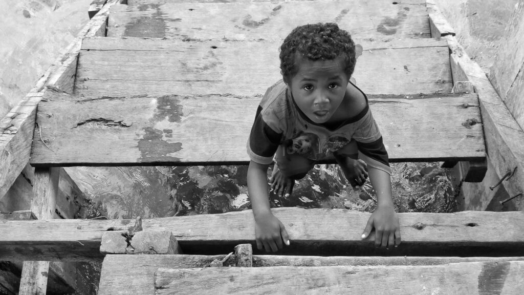 Photograph of a boy sitting on stairs
