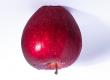photograph of an upside down apple